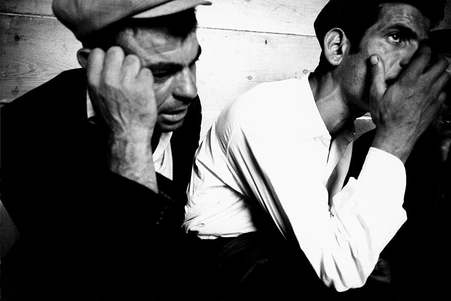 Orgosolo. Choir singers in a tavern, 1960