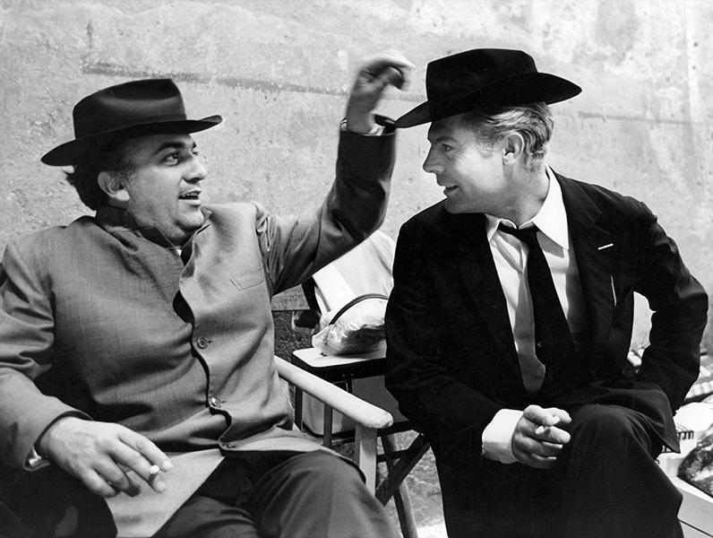 Federico Fellini and Marcello Mastroianni on the set of Otto e mezzo, 1963